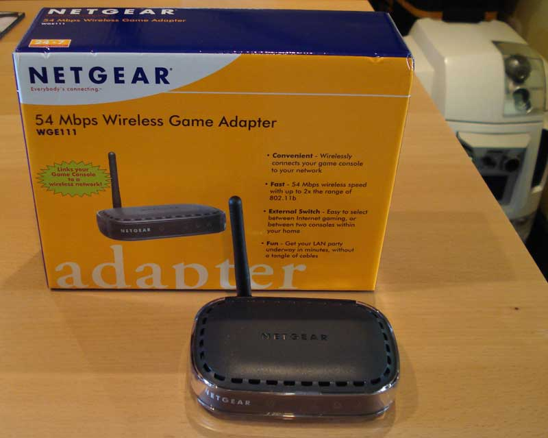 Heres The Netgear WGE111 Wireless Game Adapter It Has A Switch On Back That Allows To You Manually Choose Ad Hoc Mode Peer Or Infrastructure